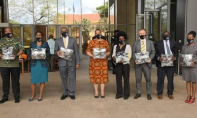 The FOSABU members display some of the masks donated to the Office of the Prime Minister.