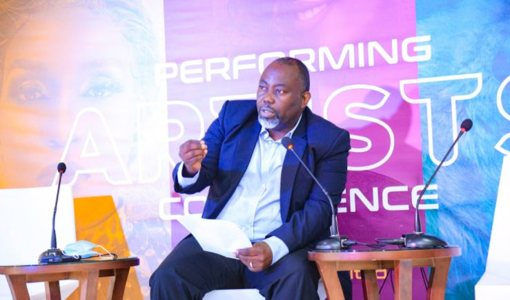 Richard Kawesa, an author speaking during the Performing Artists Conference.