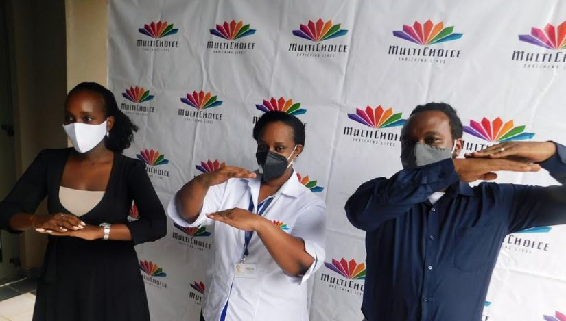 L-R;  Ms. Joan Semanda Kizza, the PR and Communications Manager for MultiChoice Uganda, Ms. Nellie Mwandha, the Head of Customer Retention at MultiChoice Uganda and Mr. Colin Asiimwe the Head of Marketing for MultiChoice Uganda pose for a photo during the launch of the  Step Up Campaign.