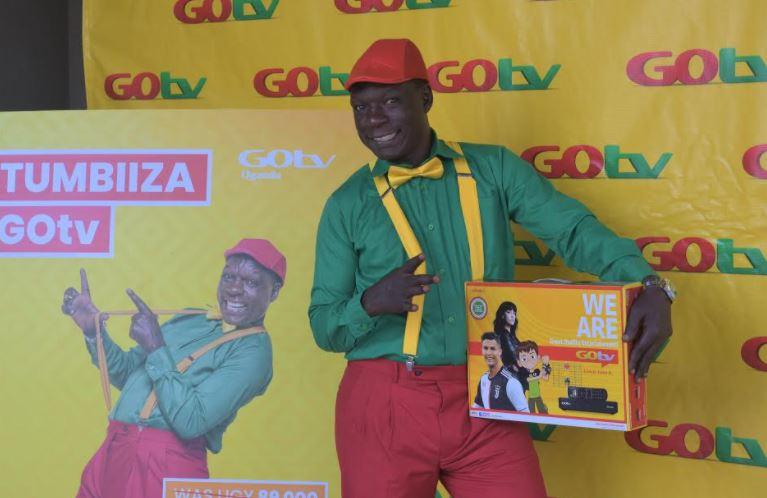Comedian Dickson Ssentongo alias Zzinzinga, the GOtv brand ambassador poses for a photo at the announcement of GOtv's new offer.
