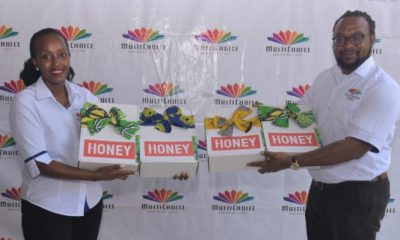 Joan Semanda Kizza, the PR and Communications Manager and Colin Asiimwe, the Head of Marketing at MultiChoice Uganda during the launch of HONEY TV