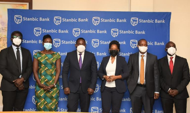 """Stanbic Bank team poses for a picture after the """"Now-Now"""" campaign launch"""