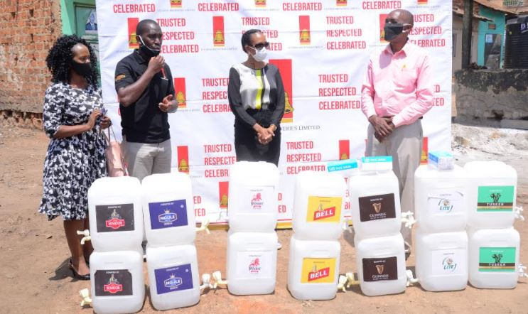 Uganda Breweries Limited has donated over 200 hand washing units to the communities of Luzira and Port Bell and over 800 face masks to Local Council leaders to promote public hygiene in the fight against COVID-19.