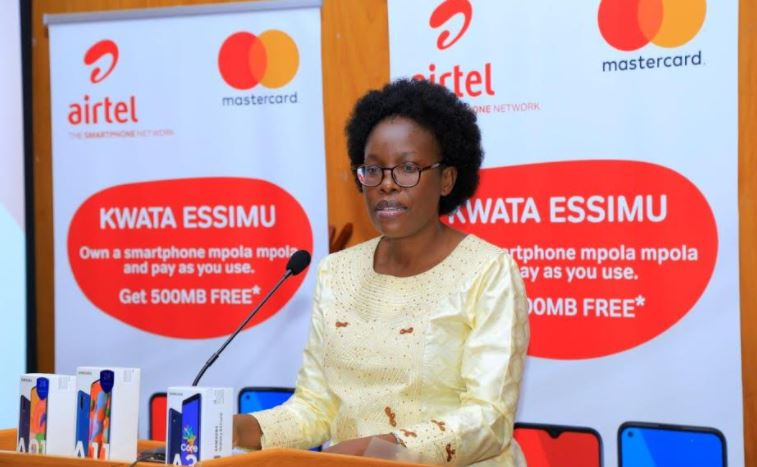 """Hon. Judith Nabakooba, Minister of ICT gives her remarks at the """"Kwata Essimu"""" campaign launch."""
