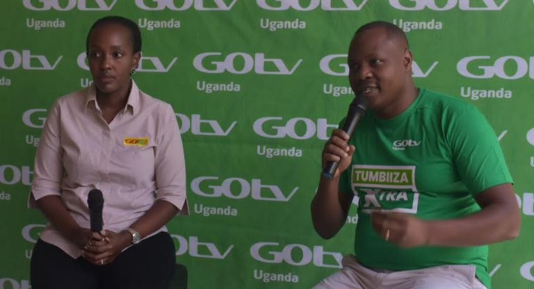 Ms. Joan Semanda Kiiza (L), the PR and Communications Manager and Mr. Jonah Wegoye, the Head of Sales MultiChoice Uganda during the launch of a new GOtv offer.