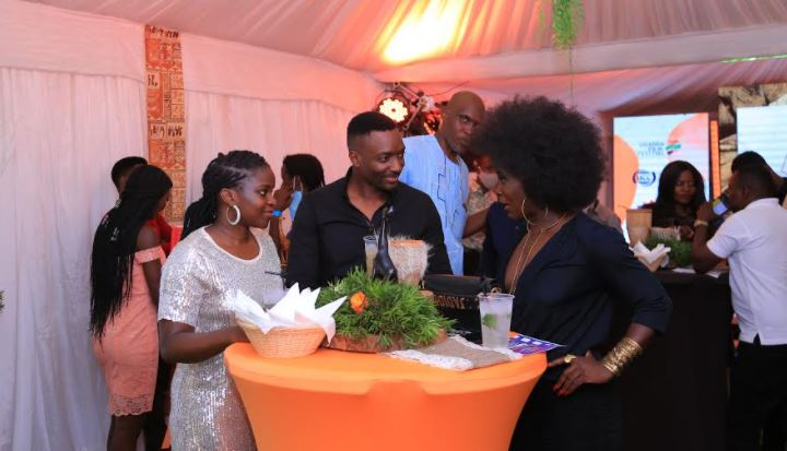 Eleanor and Matthew Nabwiso chat with actress Nana Kagga during the launch of the 8th edition of the Uganda Film Festival (UFF) at Acacia Mall, Kisementi on Monday.