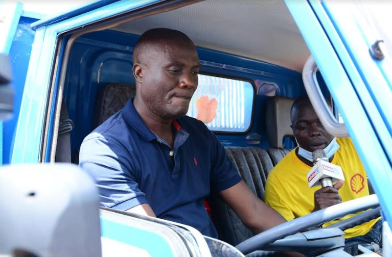 Steven Waira Mugalo  (Centre), who emerged as the second grand winner of a brand new Toyota Elf Truck in the ongoing Juuza Akameeza promotion.