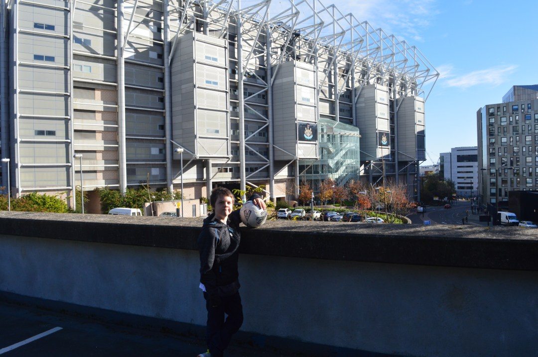 A day trip to Newcastle means a photo with Newcastle Football stadium in the background