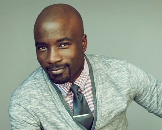 I couldn't find a shirtless pic, so here's Mike Colter in a cardigan!