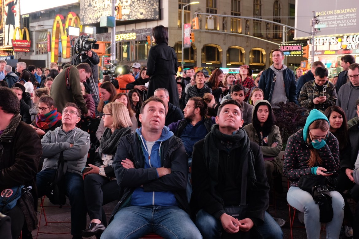 The masses staring up at the Jumbotron screen