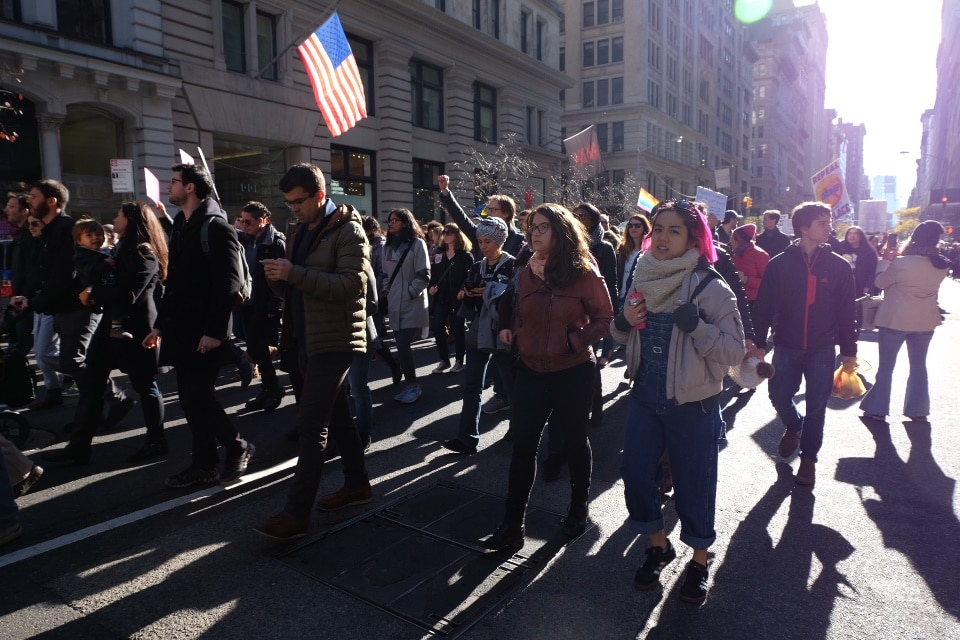 Walking up 5th Ave with the stars and stripes in the sunshine