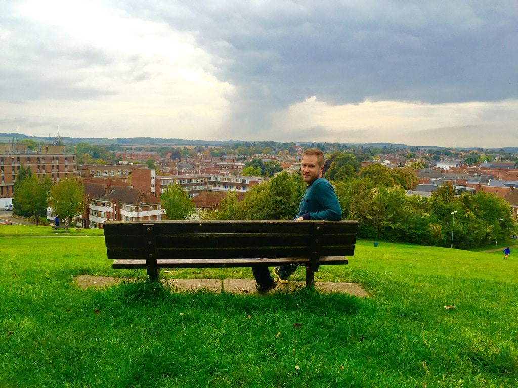Sitting on the Doctor Foster bench at the top of Windmill Hill