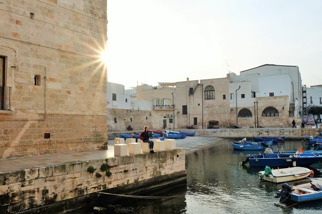 Looking out over the blue boats in Monopoli Harbour, Puglia, Italy