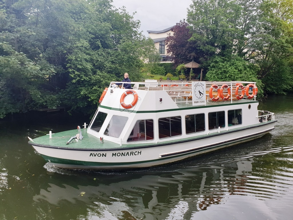 The Avon Monarch boat passing on the river