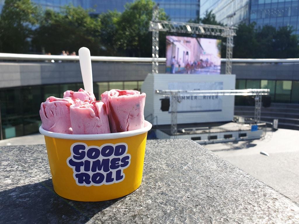 Ice cream cup plus Scoop amphitheatre in the background