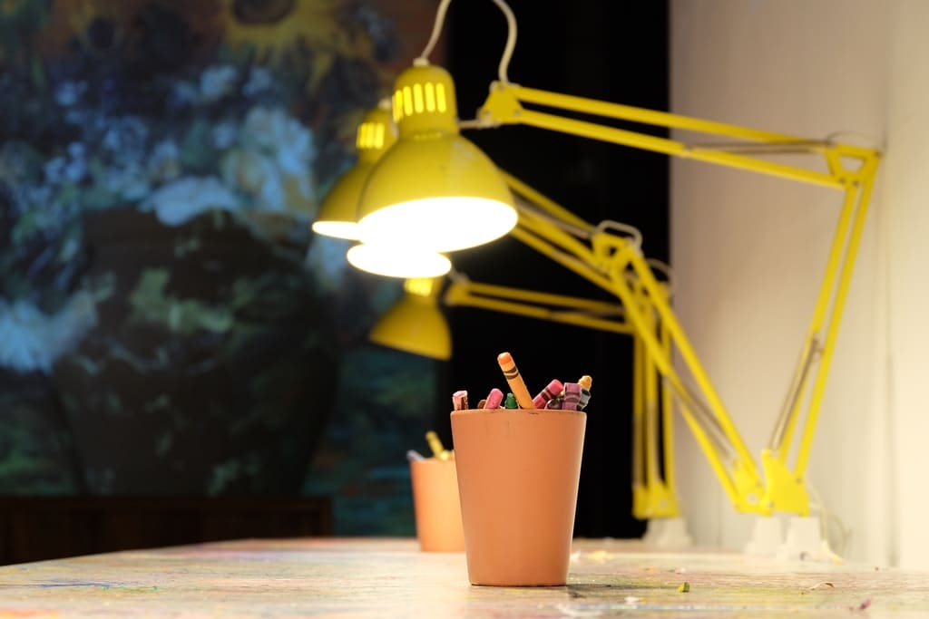 Crayola and yellow lamp stands