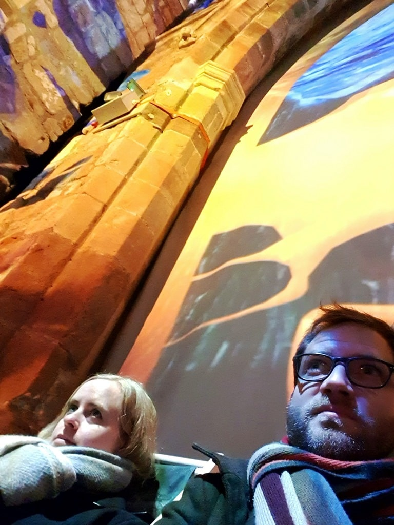 Two people sat in the St Mary's church light show