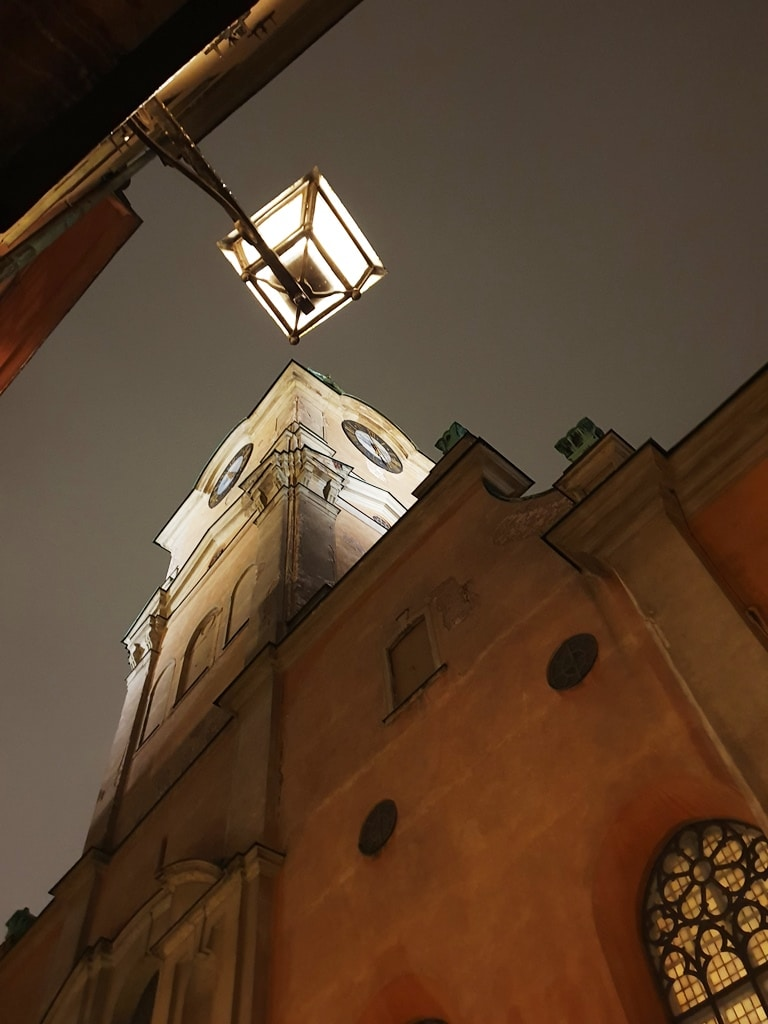 Imposing Storkyrkan Cathedral together with a lit lantern