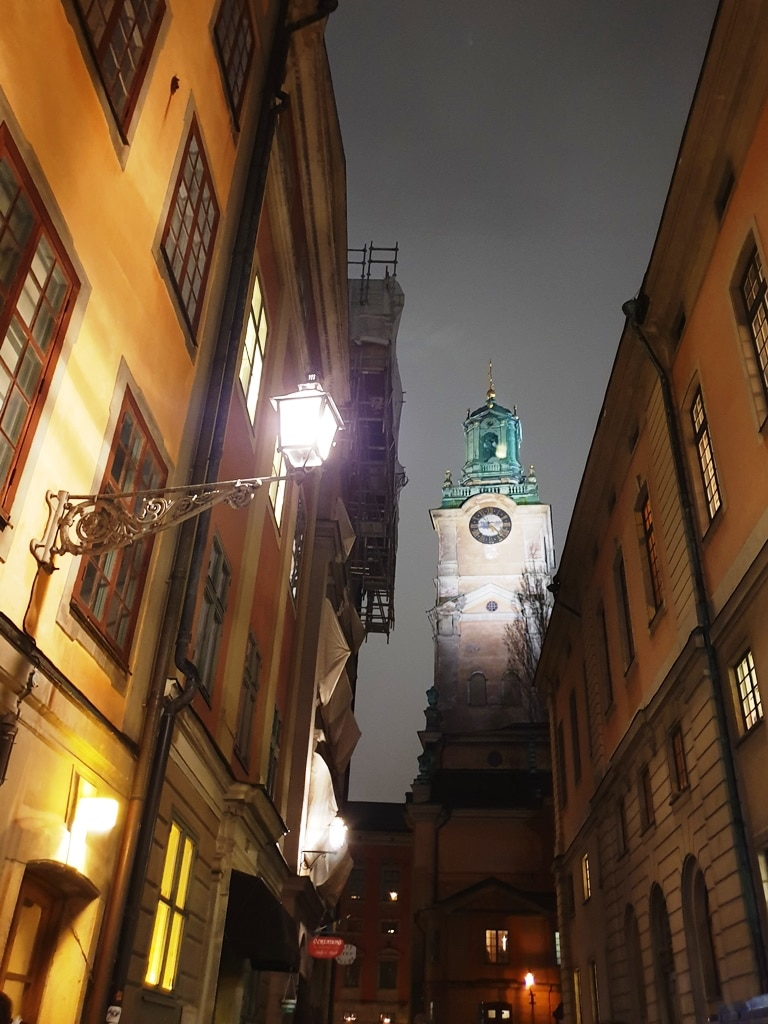 Storkyrkan Cathedral with a lit lantern in the foreground