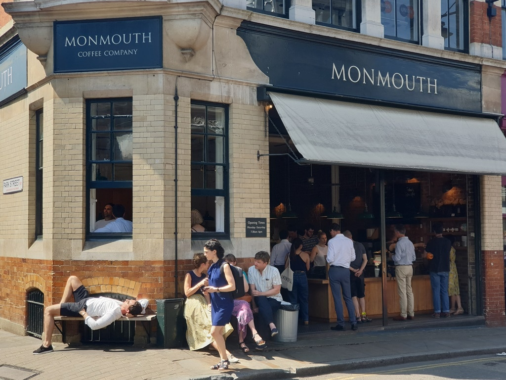 Outside of the Monmouth Coffee Company on a sunny day