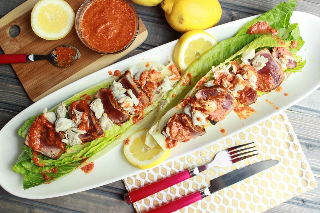 ahi tuna, lump crab, red pepper, pesto, romaine, seafood salad