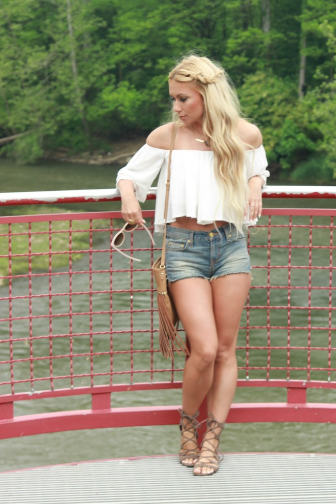 white off the shoulder top, destroyed denim shorts, gladiator sandals