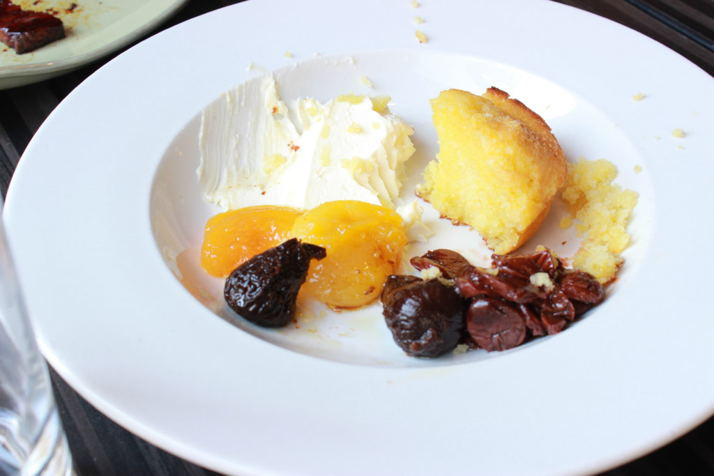 Brunch in Indy: Pioneer. Olive oil and polenta cake with stewed fruit.