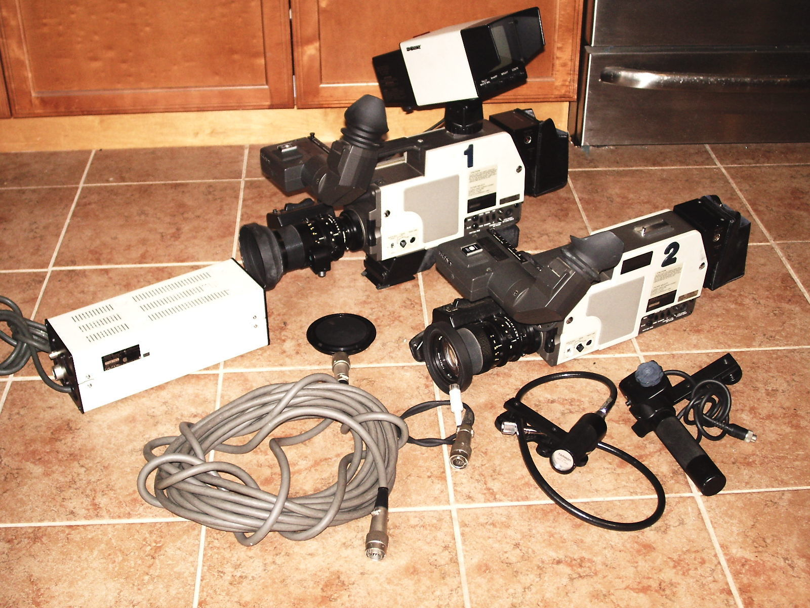 hight resolution of stock shot of two sony dxc 1820 cameras note ac power supply breakout box unit and fat cable that enabled the cameras to be used in a studio setting