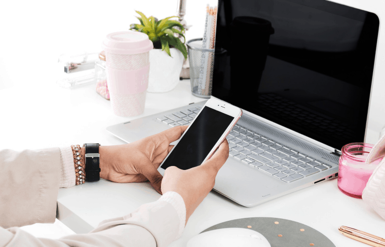 laptop and iphone with women's hands