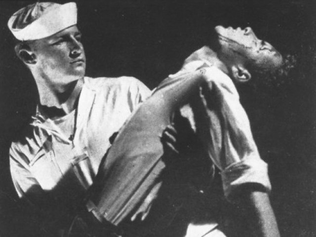 fireworks-1947-001-sailor-holding-man-in-his-arms-bfi-00o-0vp.jpg