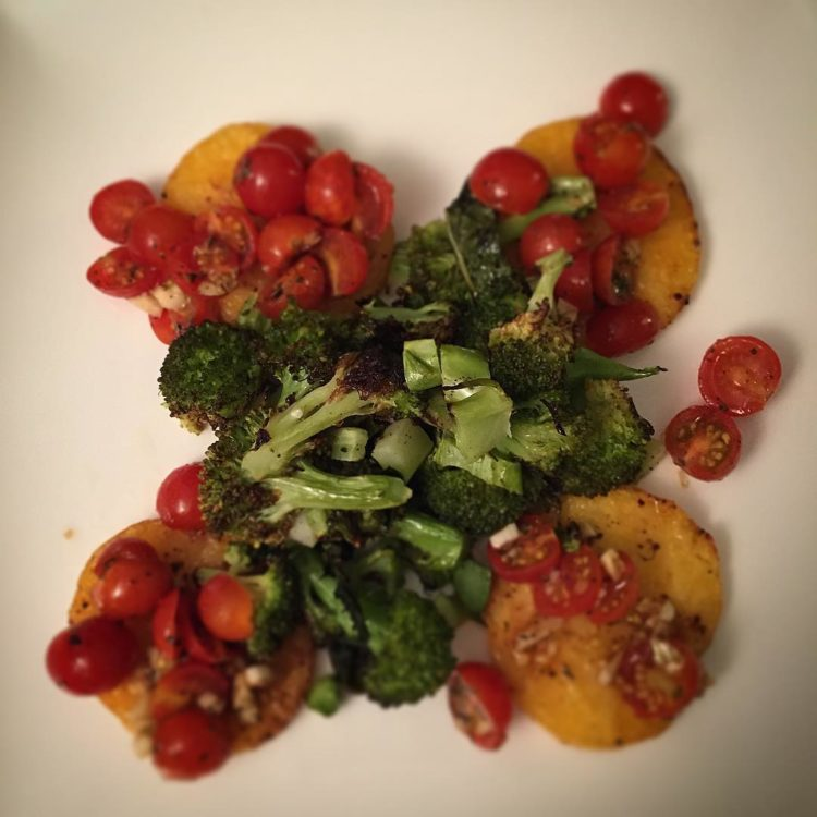 On the menu tonight: Oven baked polenta rounds topped with balsamic tomatoes served with roasted broccoli.