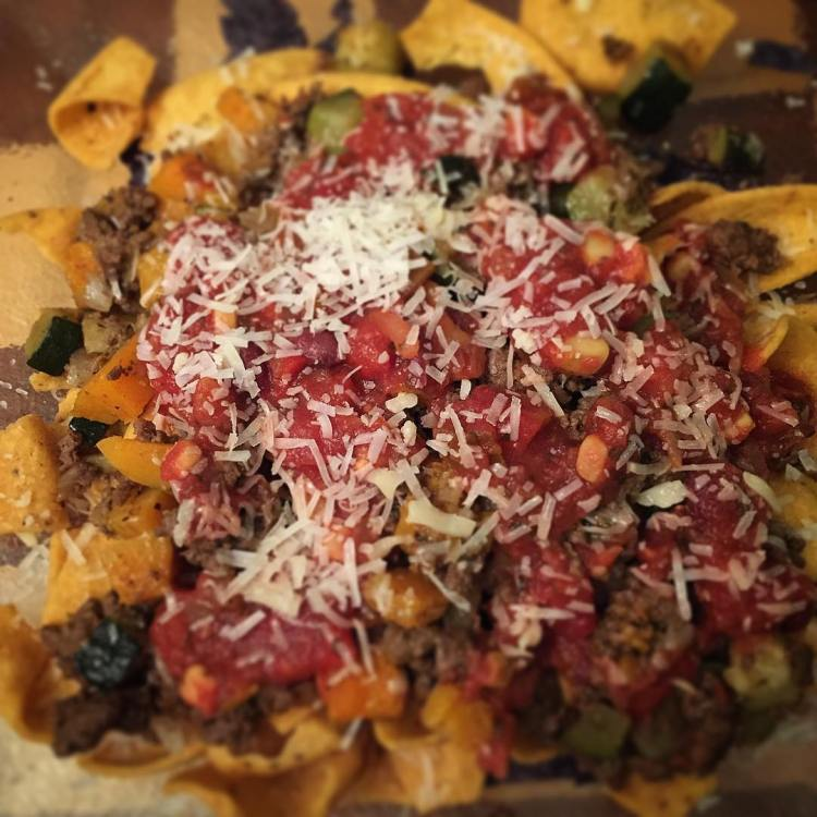 Butternut squash and zucchini taco nachos. That's right...deliciousness on a plate topped with mango cheese and black bean and corn salsa.
