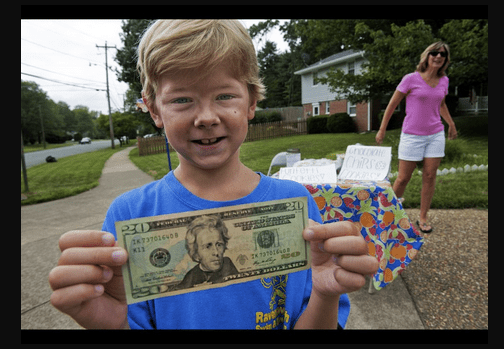 8-Year Old Johnny Garlinchak is all smiles. Can you gues why? Photo via Huffington Post