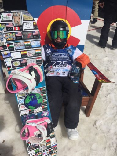USA --- Connor, one of the top skiers for his age in the USA, plastered his snowboard with stickers of global kids' BPF art and was photographed with his board at the USASA races