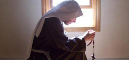 Praying and Kneeling Nun Sister Wide Pic 2
