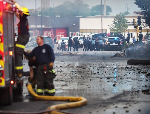 Image showing a firefighter and police in Minneapolis