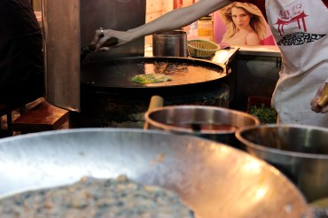 Oyster pancake being prepared. Keelung Night Market.
