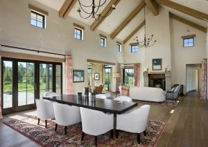 Dykema's great room features timbered ceilings and fireplaces on both ends. She mixes and matches patterns and textures throughout.