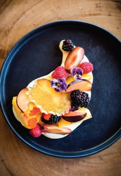 Seasonal Fruit and Sabayon, a light and fresh Horn & Cantle dessert featuring stone fruit, berries, citrus sabayon, and carmel tuile.