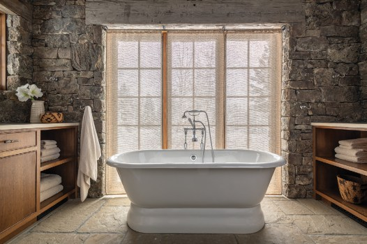 A Cheviot Regal cast iron bathtub serves as a centerpiece in the master bathroom.