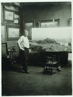 When the Land Belonged to God and Charlie Russell in his log cabin studio. • N. D. Stark photograph, 1914. CMRRC (TU2009.39.565oa)