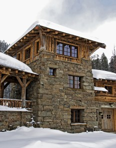 Demonstrating Pearson Design Group's range of style and adaptability. The rustic style of this stone and log home is a combination of Adirondack and mountain style.