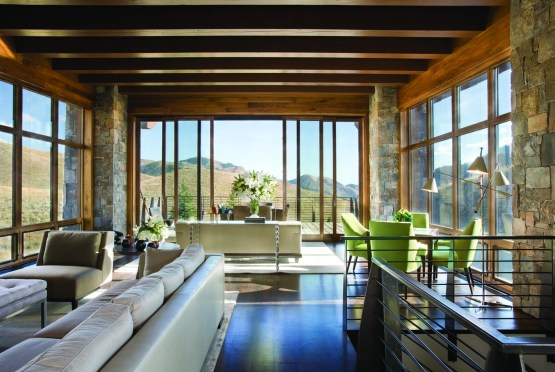 While maintaining a respectful low profile from downtown Ketchum, Idaho, the residence takes full advantage of private sweeping vistas of the Wood River Valley.