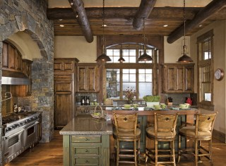 The kitchen doubles as a place to entertain but also to linger over a private cup of coffee and the morning paper, with views that alight toward the woods.