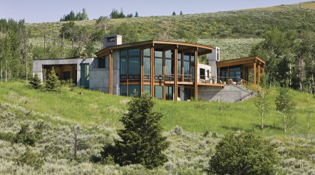 Keeping a small footprint, Ward + Blake Architects designed this Wilson, Wyoming residence with a wall of southern-facing windows that maximize passive solar benefits and blur the line of inside and outside space.