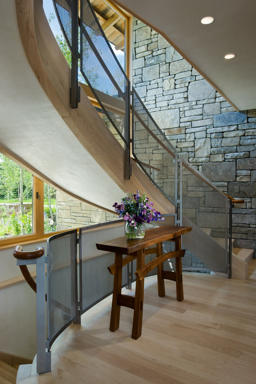 The only new wood used in the house is the flooring and this stairway, made by Spearhead Timberworks in British Columbia.