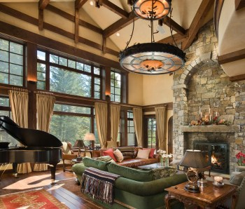 In the great room, cozy couches, a grand piano and a warm color palette imbues the home with comfort.