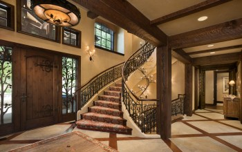 Look closely at the custom iron railing of the grand staircase and you can see birds — Mrs. Hennessy's idea — hiding among the aspen leaves.
