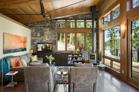 Because of their durability and water resistance, concrete floors were a natural choice for the entire cabin, and the slab-on-grade construction keeps them cool even on the hottest days. Schlauch Bottcher Construction ground down the concrete so that the aggregate is exposed, a detail that ties the floor further to the cabin's lakefront setting.