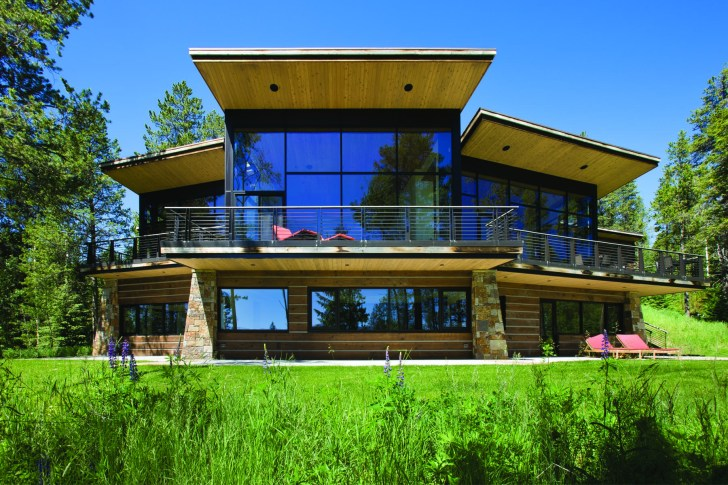 On the eastern side of the home, the design makes a vertical drop and opens out toward the landscape.